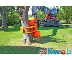 Захват с пилой для валки деревьев